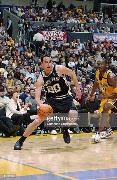 Emanuel Ginobili of the San Antonio Spurs drives around Kobe Bryant of the Los Angeles Lakers in Game six of the Western Conference Semifinals during...