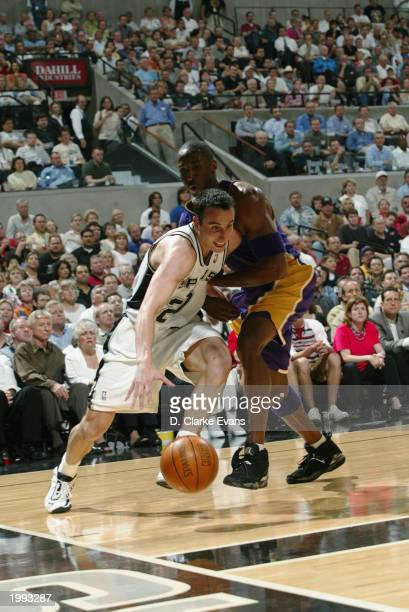 Emanuel Ginobili of the San Antonio Spurs drives baseline around Kobe Bryant of the Los Angeles Lakers in Game One of the Western Conference...