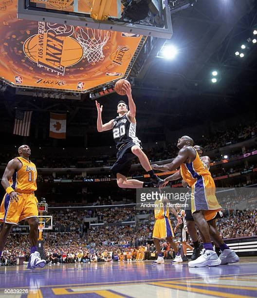 Emanuel Ginobili of the San Antonio Spurs drives to the basket past Shaquille O'Neal of the Los Angeles Lakers in Game Four of the Western Conference...
