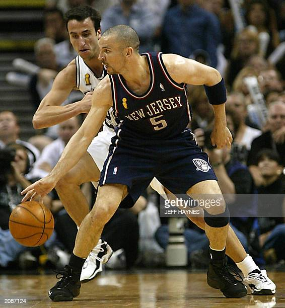 Emanuel Ginobili of the San Antonio Spurs guards Jason Kidd of the New  Jersey Nets in 1ec1a7493