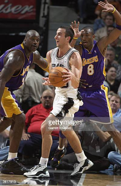 Emanuel Ginobili of the San Antonio Spurs passes the ball as he is doubleteamed by Shaquille O'Neal and Kobe Bryant of the Los Angeles Lakers at the...