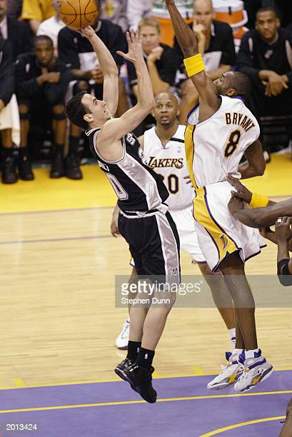 Emanuel Ginobili of the San Antonio Spurs shoots a jumpshot over Kobe Bryant of the Los Angeles Lakers in Game four of the Western Conference...