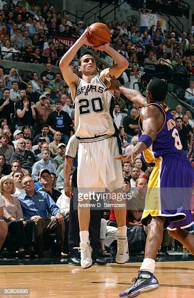 Emanuel Ginobili of the San Antonio Spurs shoots over Kobe Bryant of the Los Angeles Lakers in Game one of the Western Conference Semifinals during...