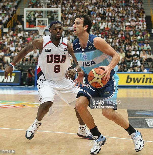 Emanuel Ginobilo of Argentina drives to the basket against LeBron James of the USA during the 2006 FIBA World Championship Classification Round on...