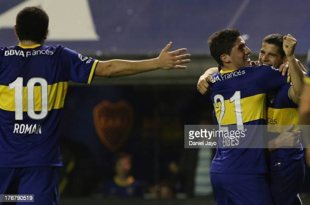 Emanuel Insua of Boca Juniors, celebrates with Roman Riquelme and Cristian Erbes after scoring during a match between Boca Juniors and Atletico...