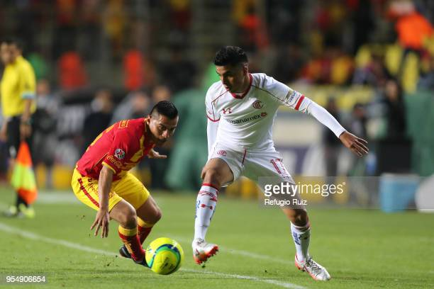 Emanuel Loeschbor of Morelia fights for the ball with Aldo Rocha of Morelia during the quarter finals first leg match between Morelia and Toluca as...
