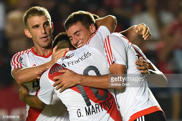 Emanuel Mammana celebrates with teammates after scoring the opening goal during a match between Colon and River Plate as part of Torneo de Transicion...
