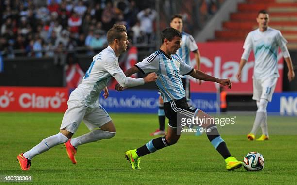 Emanuel Mammana of Argentina in action during a FIFA friendly match between Argentina and Slovenia at Ciudad de La Plata Stadium on June 7 2014 in La...