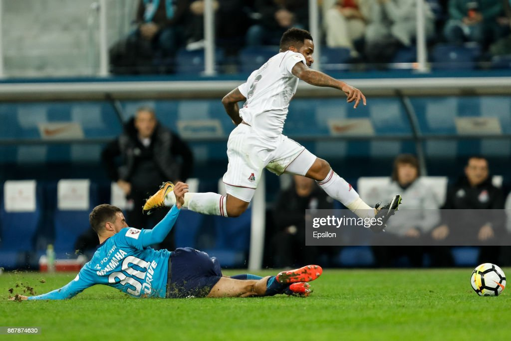 Emanuel Mammana (L) of FC Zenit Saint Petersburg and Jefferson Farfan of FC Lokomotiv Moscow vie for the ball during the Russian Football League match between FC Zenit St. Petersburg and FC Lokomotiv Moscow on October 29, 2017 at Saint Petersburg Stadium in Saint Petersburg, Russia.