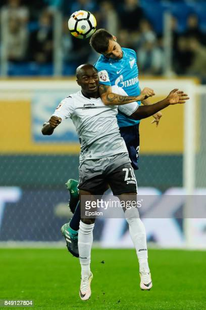 Emanuel Mammana of FC Zenit Saint Petersburg and Kehinde Fatai of FC Ufa vie for a header during the Russian Football League match between FC Zenit...