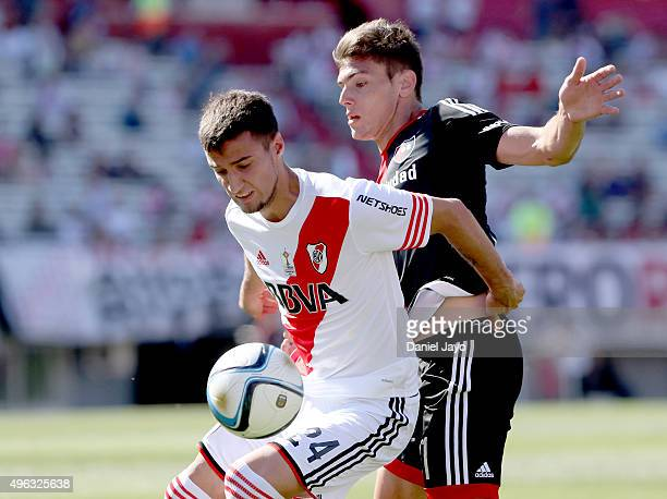 Emanuel Mammana of River Plate and Lucas Boye of Newells Old Boys fight for the ball during a match between River Plate and Newell's Old Boys as part...