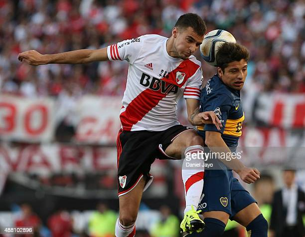 Emanuel Mammana of River Plate and Sebastian Palacios of Boca Juniors go for a header during a match between River Plate and Boca Juniors as part of...