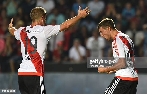 Emanuel Mammana of River Plate celebrates with Ivan Alonso after scoring the opening goal during a match between Colon and River Plate as part of...