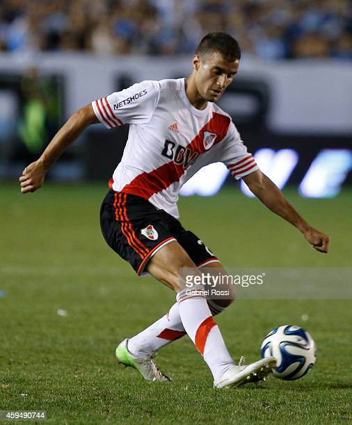 Emanuel Mammana of River Plate drives the ball during a match between Racing Club and River Plate as part of 17th round of Torneo de Transicion 2014...