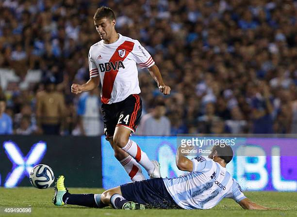 Emanuel Mammana of River Plate fights for the ball with Luciano Aued of Racing Club during a match between Racing Club and River Plate as part of...