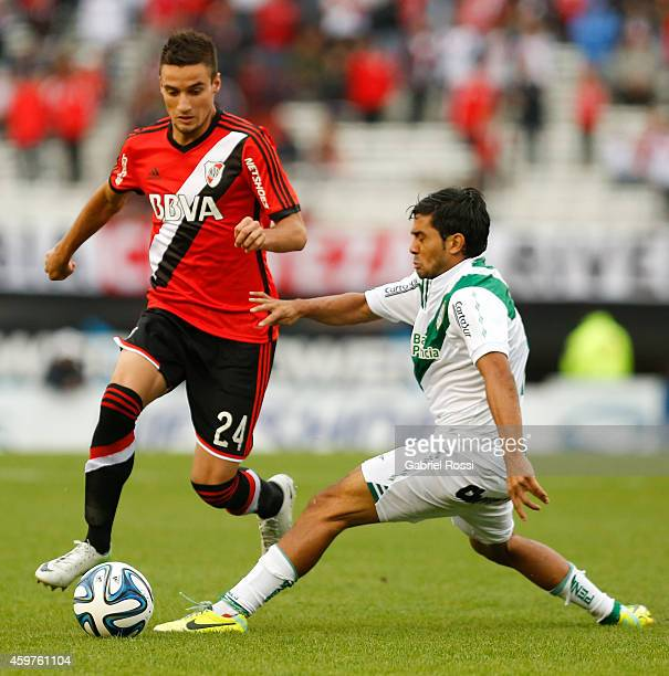 Emanuel Mammana of River Plate fights for the ball with Walter Erviti of Banfield during a match between Banfield and River Plate as part of round 18...