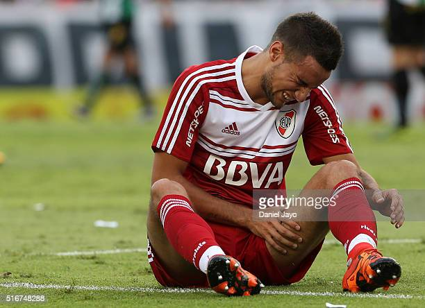 Emanuel Mammana of River Plate grimaces in pain after resulting injured during a match between River Plate and Banfield as part of round 8 of Torneo...