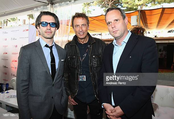 Emanuel Michael Charlie Woebcken and Kristian Kreyes attend the Medienboard reception during the 66th Annual Cannes Film Festival at La Plage 45 on...