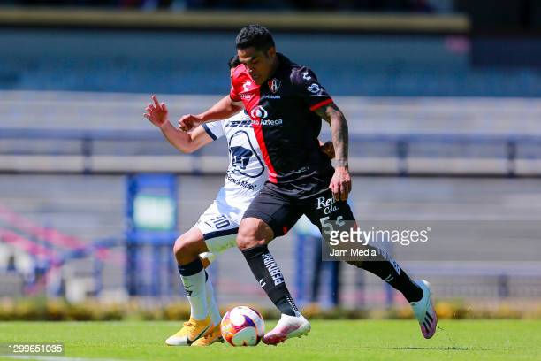 Emanuel Montejano of Pumas fights for the ball with Anderson Santamaria of Atlas during the 4th round match between Pumas UNAM and Atlas as part of...