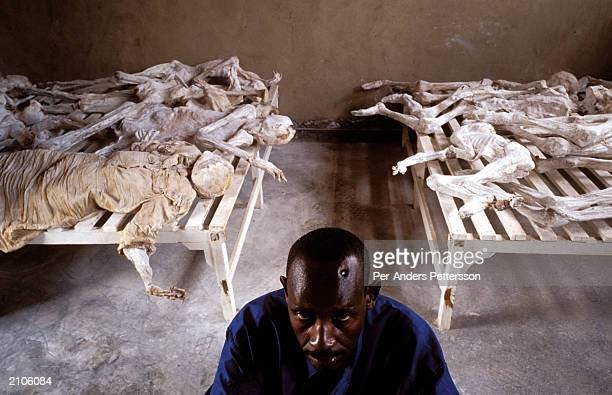 Emanuel Murangira a genocide survivor sits at the Murambi memorial site February 14 2003 in Murambi outside Gikongoro Rwanda Mr Emanuel lost his wife...