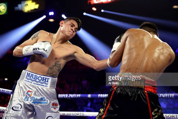 Emanuel Navarrete punches Jeo Santisima during their bout for Navarrete's WBO junior featherweight title on February 22 2020 at MGM Grand Garden...
