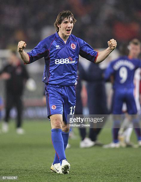 Emanuel Pogatez applauds the travelling fans after his team progressed to the next round with an away goals victory during the UEFA Cup last sixteen...