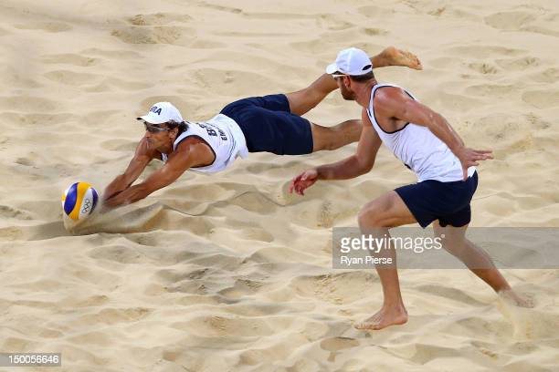 Emanuel Rego and Alison Cerutti of Brazil attempt to return the ball against Jonas Reckermann and Julius Brink of Germany during the Men's Beach...