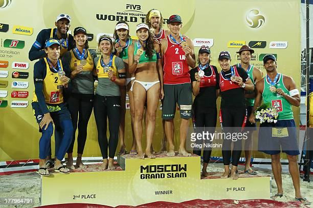 Emanuel Rego and Evandro Goncalves Oliveira Junior of Brazil, Kira Walkenhorst and Laura Ludwig of Germany, Carolina Solberg Salgado and Maria Clara...