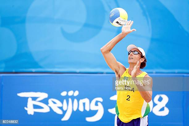 Emanuel Rego of Brazil serves against Renato Gomes and Jorge Terceiro of Georgia during the beach volleyball event at the Chaoyang Park Beach...