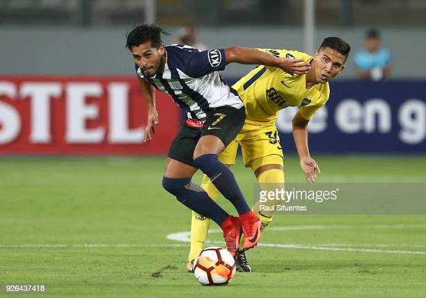 Emanuel Reynoso Boca Juniors struggles for the ball with Maximiliano Lemos of Alianza Lima during a groups stage match between Alianza Lima and Boca...
