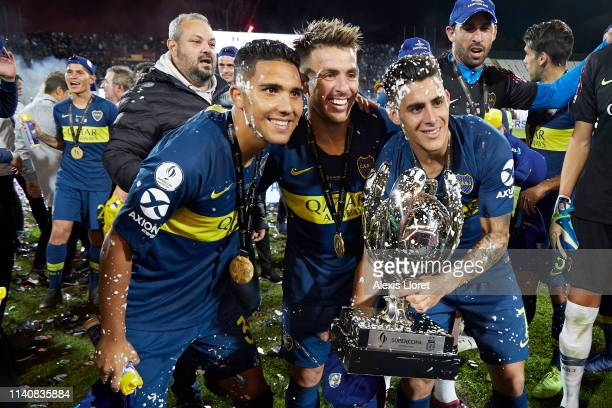 Emanuel Reynoso Julio Buffarini and Cristian Pavon of Boca Juniors celebrate with the Supercopa Argentina trophy after a match between Boca Juniors...