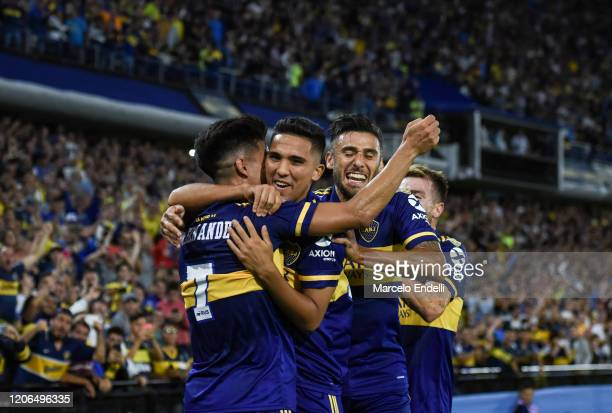 Emanuel Reynoso of Boca Juniors celebrates with teammates after scoring the third goal of his team during a Group H match between Boca Juniors and...