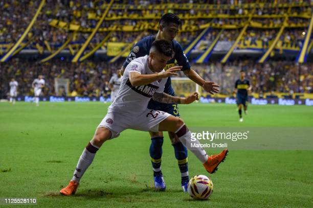 Emanuel Reynoso of Boca Juniors fights for the ball with Gabriel Carrasco of Lanus during a match between Boca Juniors and Lanus as part of Superliga...
