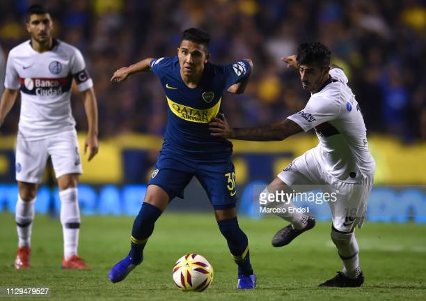 Emanuel Reynoso of Boca Juniors fights for the ball with Roman Martinez of San Lorenzo during a match between Boca Juniors and San Lorenzo as part of...