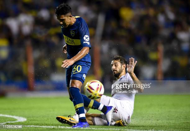 Emanuel Reynoso of Boca Juniors fights for the ball with Tomas Belmonte of Lanus during a match between Boca Juniors and Lanus as part of Superliga...