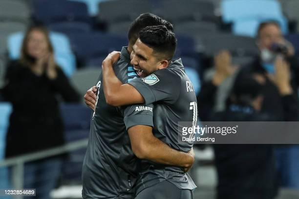 Emanuel Reynoso of Minnesota United congratulates Ramon Abila on his goal against Vancouver Whitecaps in the second half of game at Allianz Field on...