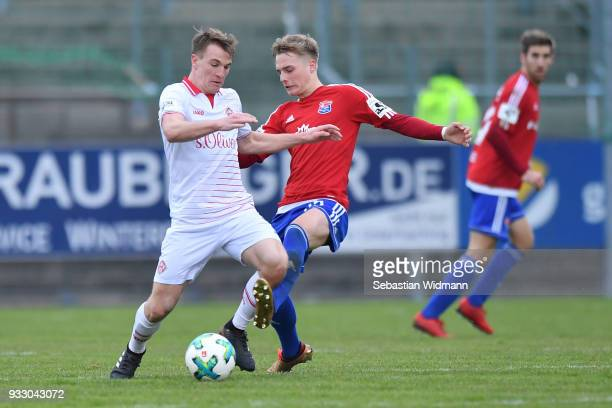 Emanuel Taffertshofer of Wuerzburg and Finn Porath of Unterhaching compete for the ball during the 3. Liga match between SpVgg Unterhaching and FC...