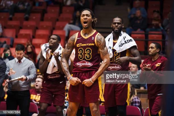 Emanuel Terry of the Canton Charge and Jacorey Williams of the Canton Charge celebrate a layup by their teammate Scoochie Smith late in a game...