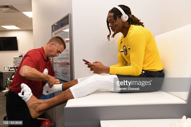 Emanuel Terry of the Denver Nuggets is taped up before a preseason game against the Perth Wildcats on October 5 2018 at Pepsi Center in Denver...