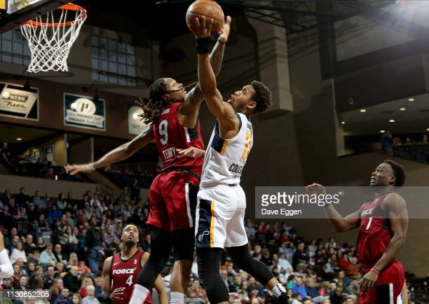 Emanuel Terry of the Sioux Falls Skyforce tries to block the shot of Isaiah Cousins of the Salt Lake City Stars during an NBA GLeague game on March...