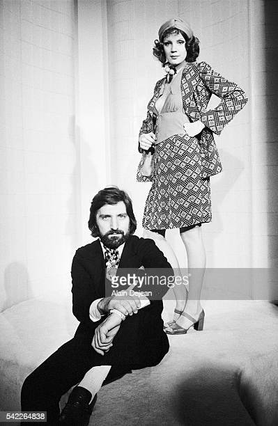 Emanuel Ungaro poses with one of his models during his 1972 Spring/Summer fashion collection.