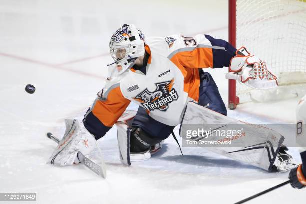 Emanuel Vella of the Flint Firebirds makes a blocker save in the first period during OHL game action against the London Knights at Budweiser Gardens...