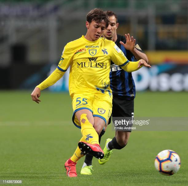 Emanuel Vignato of Chievo Verona is challenged by Cedric Soares of FC Internazionale during the Serie A match between FC Internazionale and Chievo at...