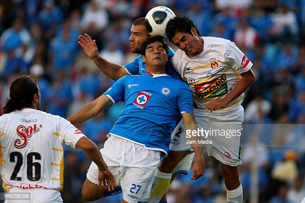 Emanuel Villa and Javier Orozco of Cruz Azul vie for the ball with Enrique Perez of Morelia during their semifinals match as part of the 2009 Opening...
