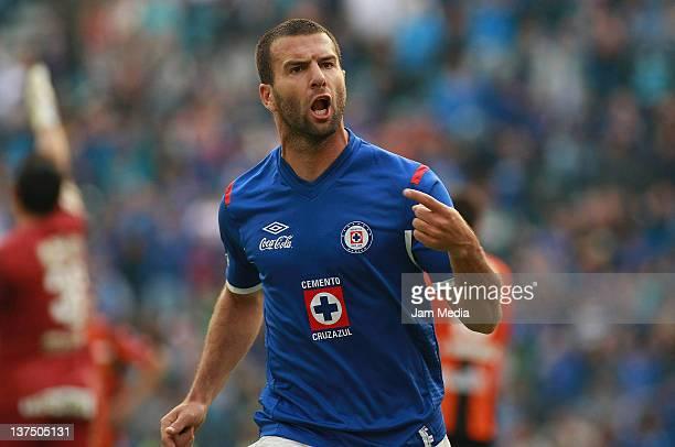 Emanuel Villa of Cruz Azul celebrates a scored goal during a match between Cruz Azul v Pachuca as part of the Clausura 2012 at Blue Stadium on...