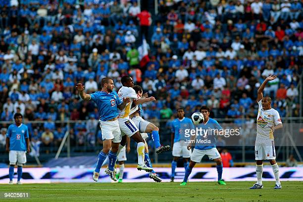 Emanuel Villa of Cruz Azul vies for the ball with Wilson Toago of Morelia during their semifinals match as part of the 2009 Opening tournament in the...