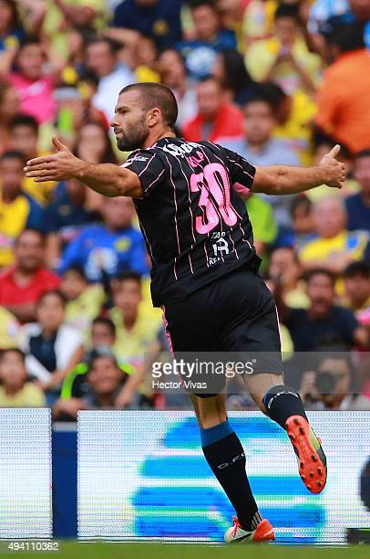 Emanuel Villa of Queretaro celebrates after scoring the first gol of his team during the 14th round match between America and Queretaro as part of...