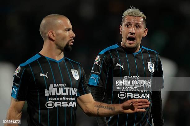 Emanuel Villa of Queretaro talks to his teammate Yaser Corona during the fourth round match between Santos Laguna and Queretaro as part of the...