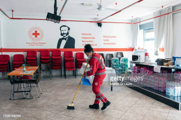 Emanuela Ritota crew member of an Italian Red Cross ambulance sweeps the floor of a common area while waiting for an emergency call on April 8 2020...