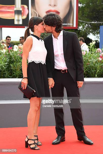 Emanuela Sartoretti kisses Andrea Sartoretti as they attend the JaegerLeCoultre Glory To The Filmmaker Award To Amir Naderi and premiere of...
